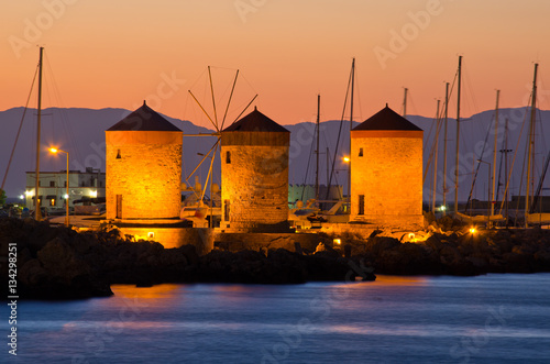 Tuinposter Stad aan het water Windmills in the port of Rhodes, Greece