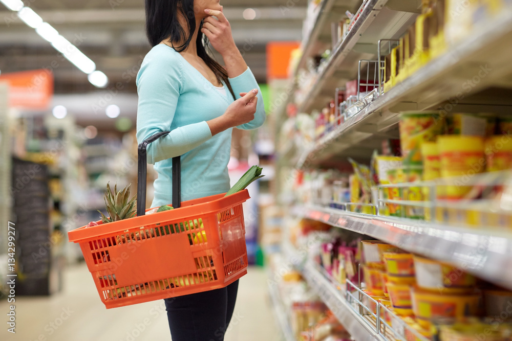 Fototapety, obrazy: woman with food basket at grocery or supermarket