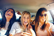 canvas print picture Three vivacious girlfriends on a road trip