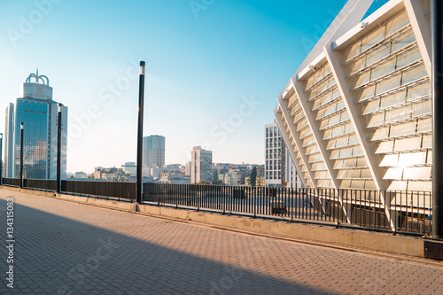 Foto op Plexiglas Stadion City at daytime. Buildings and blue sky. Stadium and business center.