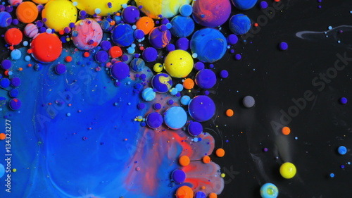 Stream Of Colorful Bubbles Moving On Paint Surface Black