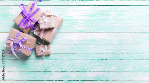 Festive gift boxes with presents on turquoise background.