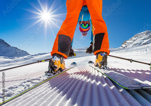 Garden Poster Winter sports Skier posing on piste in high mountains