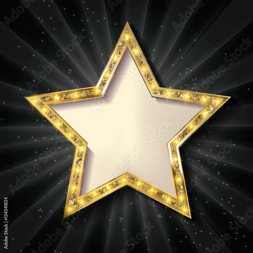 Photo  Gold star on a dark background.