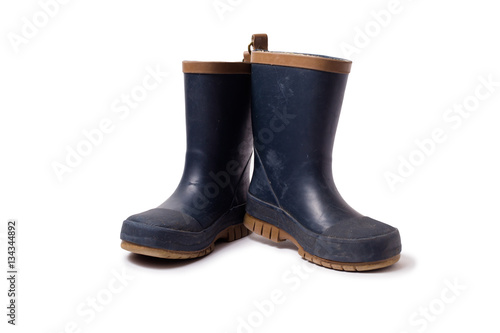 Blue worn gumboots on white background
