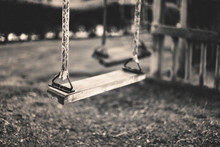 Monochrome Image Empty Swing At The Playground In Summer, Horizo