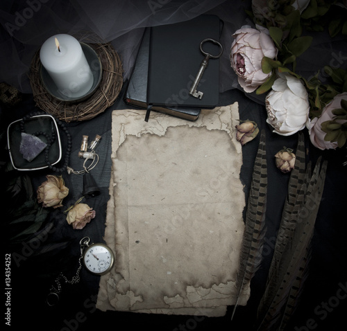 Fotografie, Obraz  Vintage table with paper, flowers, old watch and candle