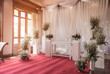 Interior ceremony wedding room decoration by red carpet and fabr