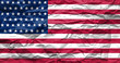 Zerknüllte US-amerikanische Flagge aus Papier.