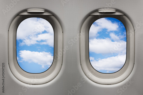 Tuinposter Vliegtuig Sky with white clouds viewed from inside an airplane windows