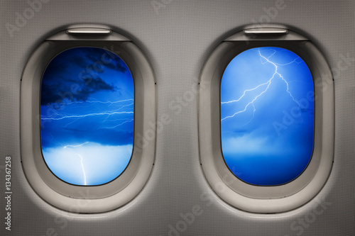 Tuinposter Vliegtuig Ligthning storm viewed from inside an airplane windows
