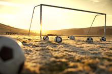 Soccer Balls On An Empty Field...