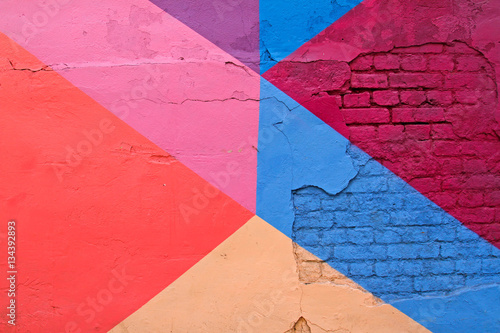 Poster Graffiti Colorful (purple, blue pink and beige) brick wall as background, texture