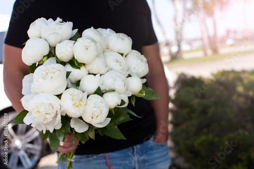 Fotografie, Obraz  Man with bouquet of nice white peonys.