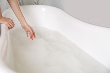 Woman Making Bubble Bath