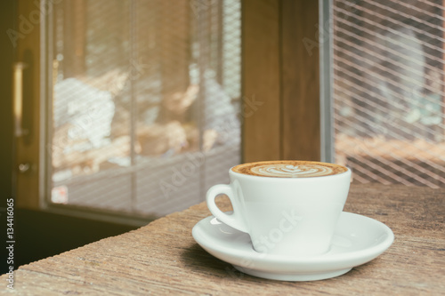 Fototapeta Cup of cappucciono coffee at  cafe. Vintage filter style blur pe obraz na płótnie