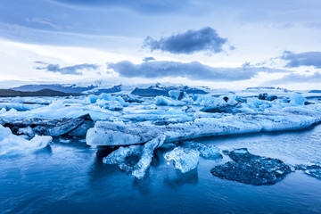 Icebergs floating in Jokulsarlon glacial lagoon.