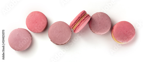 Pastel coloured macarons forming a row on white
