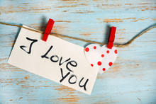 I Love You Message With Polka Dots Heart Pin On Old Rope With Red Clips On Wooden Blue Paint Background. Love Or Valentine's Day Concept