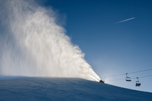 Landscape Of Snow Cannons Working At The Ski Slope On A Sunny Da