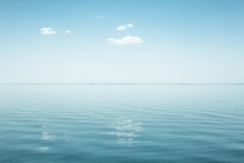 Calm Sea With Windmill