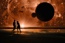 Silhouettes Of Loving Couple, Walking Along The Beach And Imagine In The Sky, The Universe, Stars And Planets. People Are On Another Planet. Elements Of This Image Furnished By NASA