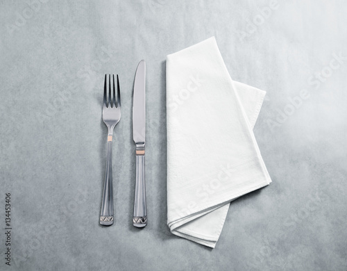 Fotografie, Obraz  Blank white restaurant napkin mockup with knife and fork, isolated