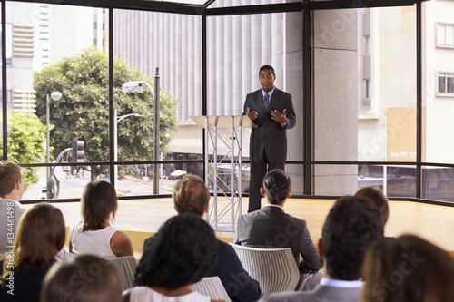 Valokuva  Black businessman presenting seminar gesturing to audience