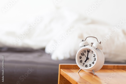Good morning with alarm clock on bedside table Wallpaper Mural
