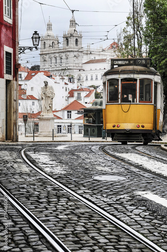 Old tram in the streets of Lisbon Plakat