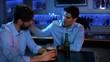 Man comforting his depressed friend in bar 4K