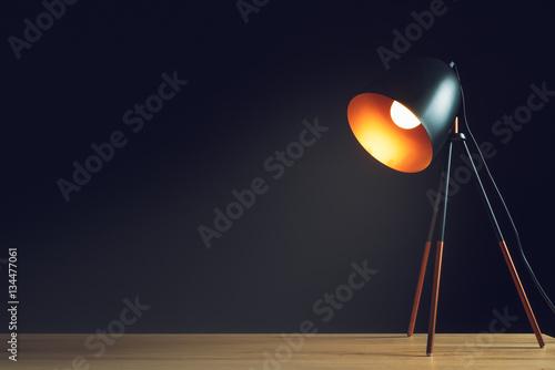 Fotografie, Obraz  Desk lamp on empty wooden office table