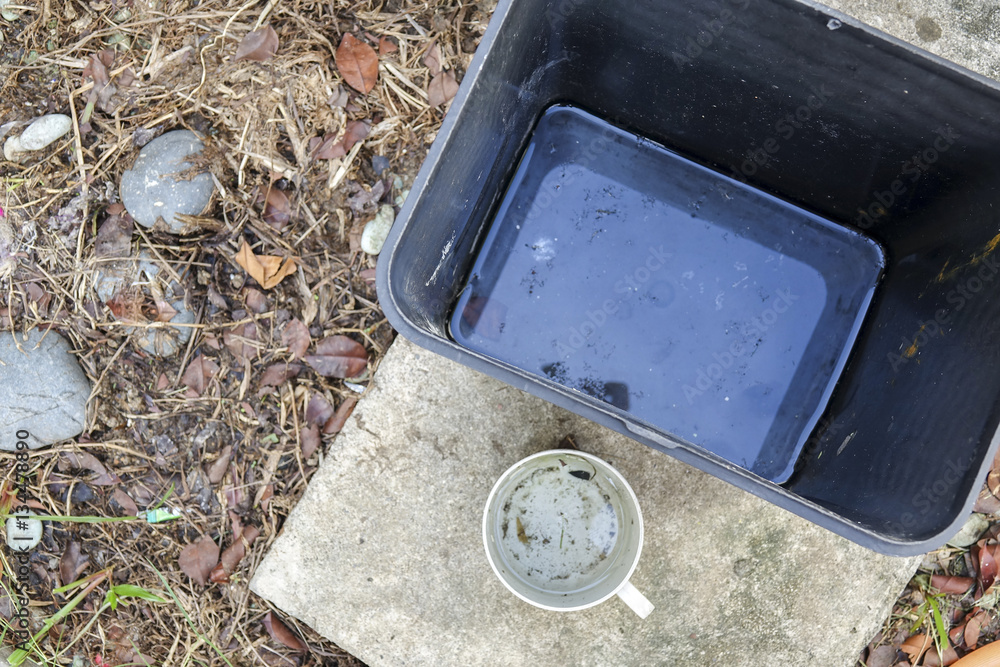 Valokuva  Stagnan water in rubbish container and plastic cup potentially for musquitoes breeding ground
