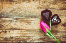 Pink Rose Bud And Two Chocolate Candy