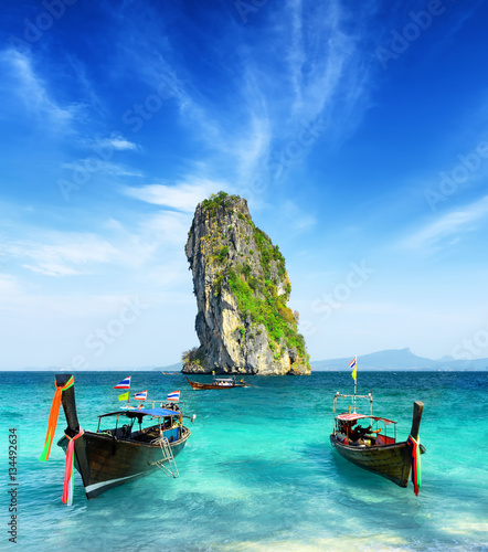 Deurstickers Tropical strand Two boats and a rock in the sea. Krabi province