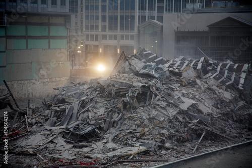 Obraz na plátně Building demolition with explosivesin downtown city center