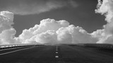 Free highway on a background of beautiful clouds. black and whit - 134505678