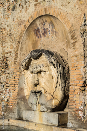 Photo  Mask fountain in courtyard of Santa Sabina Basilica. Rome, Italy