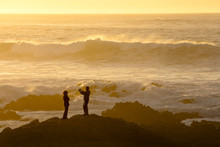 Young Couple At Sunset At Asilomar State Beach Near Monterey, Ca