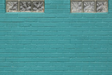 Turquoise Painted Brick Wall With Windows