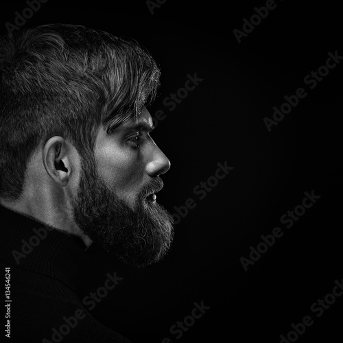 Black and white close up image of serious brutal bearded man on Poster