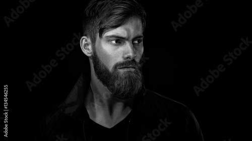 Fotomural Black and white portrait of bearded handsome man in a pensive mo