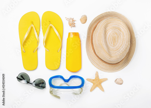Fotografia  Variety beach accessories on white background. Vacation and trav