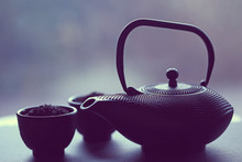 Black Teapot  And Bowls   In A...