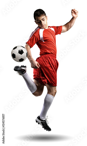 Fotografie, Tablou  The football player in action on the white background.