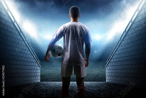 Football player with ball in the stadium Tablou Canvas