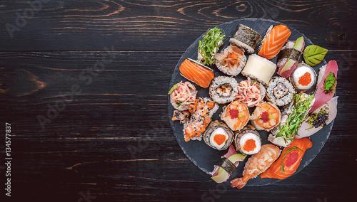 Foto op Aluminium Sushi bar sushi on a black wooden surface