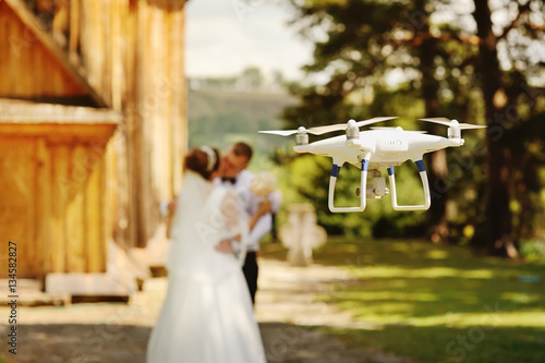 Valokuva  dron filming a wedding couple