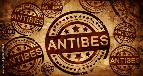 antibes, vintage stamp on paper background Wallpaper Mural