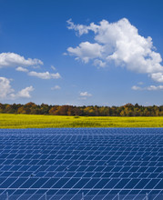 Solar Power Plant And Rapesed Field In Germany